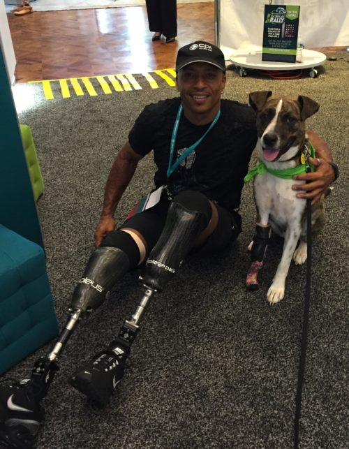 Amputee Therapy Dog Keating poses with Reggie Showers